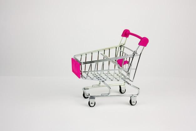 Shopping cart on light background