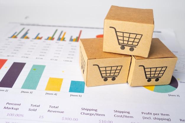 Shopping cart logo on box on graph.