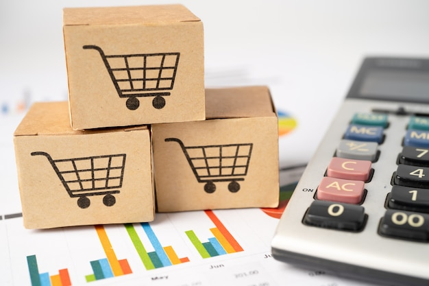 Shopping cart logo on box with calculator on graph background.