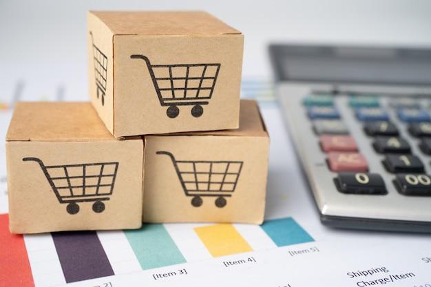 グラフ上の電卓とボックスのショッピングカートのロゴ。