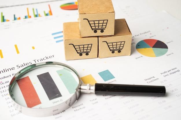 グラフの背景に虫眼鏡とボックスのショッピングカートのロゴ