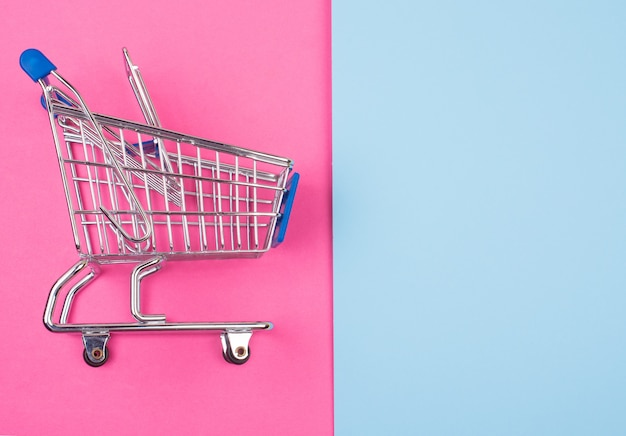 Shopping cart on the pink and blue