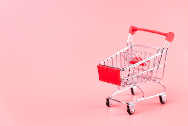 Shopping cart on plain background with copy-space