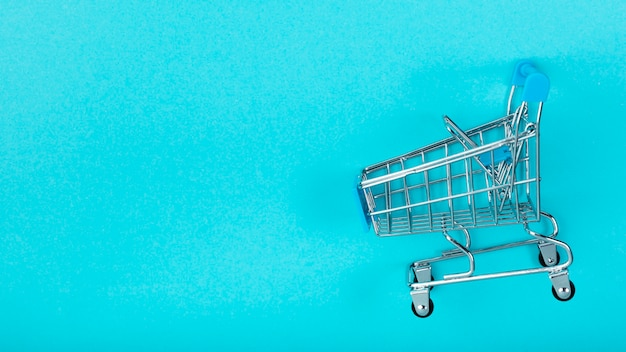 Shopping cart on plain background