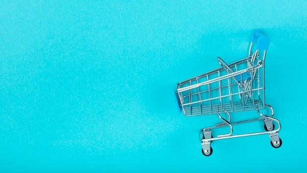 Shopping cart on plain background