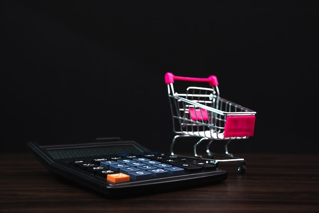 Shopping cart or supermarket trolley and calculator
