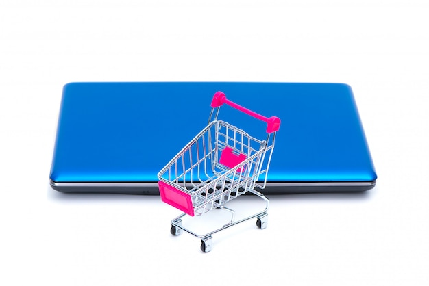 Shopping cart or supermarket trolley with laptop notebook