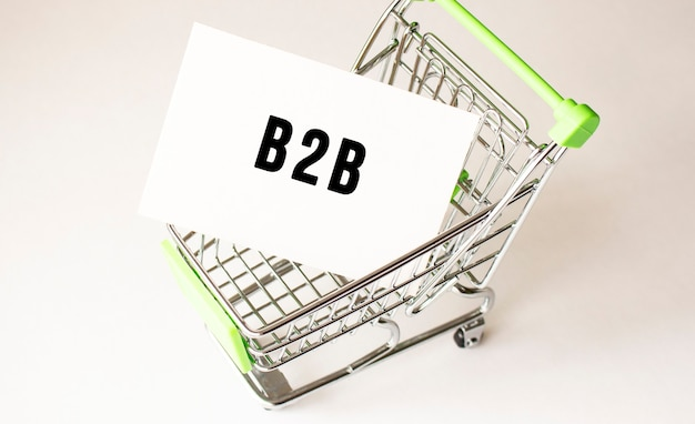 Shopping cart and text b2b on white paper