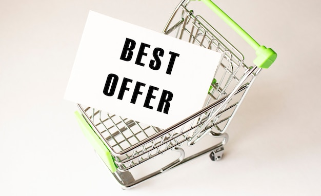 Shopping cart and text best offer on white paper. shopping list concept on light background.