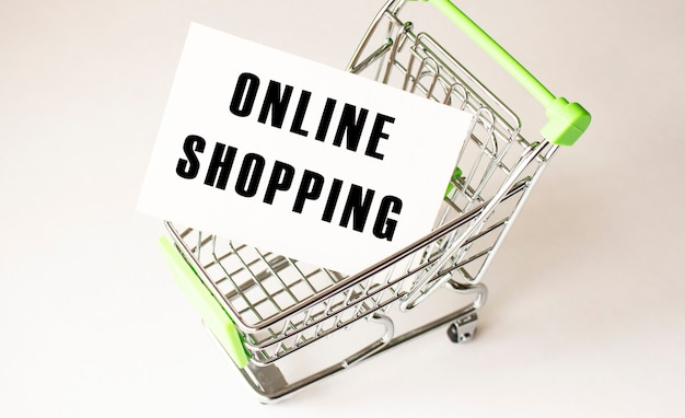Shopping cart and text online shopping on white paper. shopping list concept.