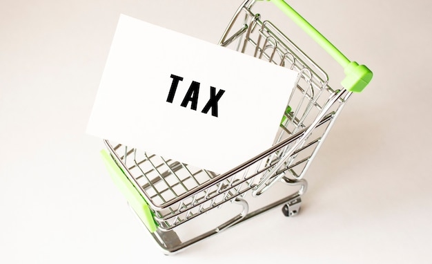 Shopping cart and text tax on white paper