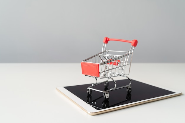 Shopping cart on top of tablet