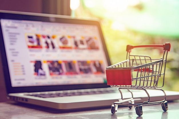 Shopping cart or trolley on a laptop keyboard