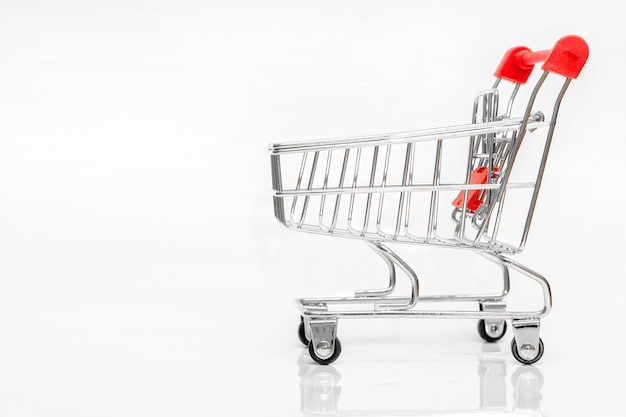 Shopping cart on white background with shadows