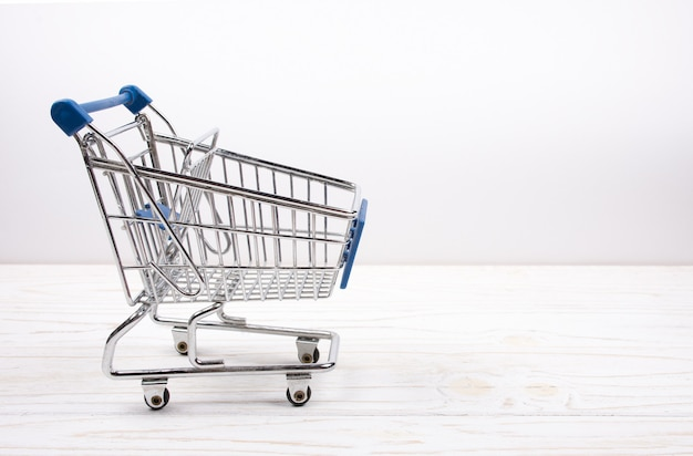 Shopping cart on a white wood