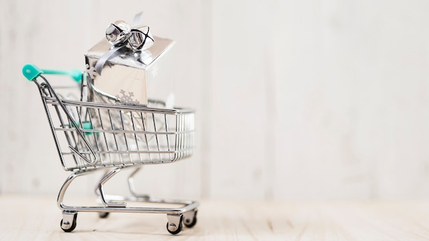 Shopping cart with christmas gift