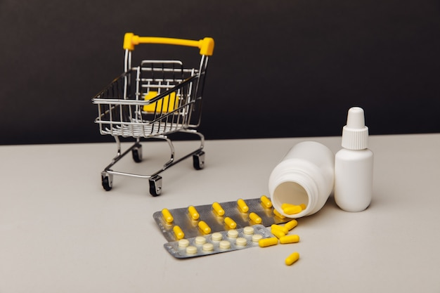 Shopping cart with compounded prescription medications shipped from a mail order pharmacy on the table