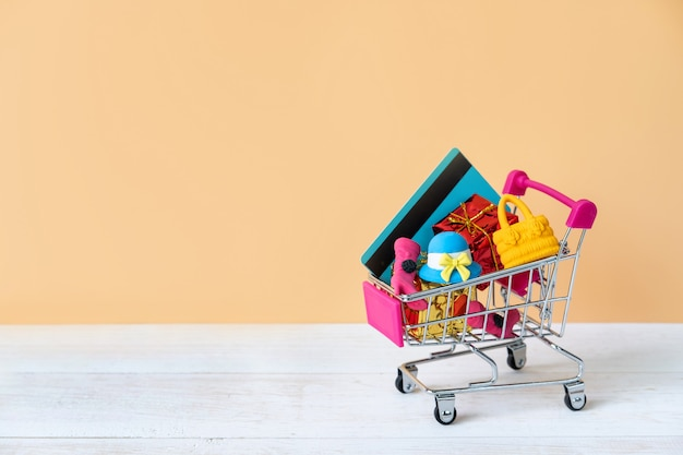 Shopping cart with credit card and woman accessories with copy space