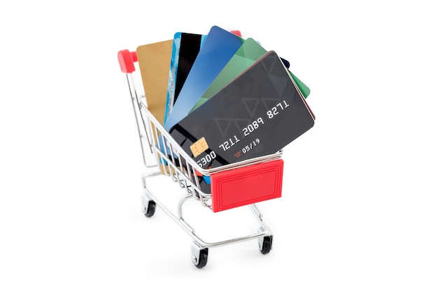 Shopping cart with credit cards on white background.