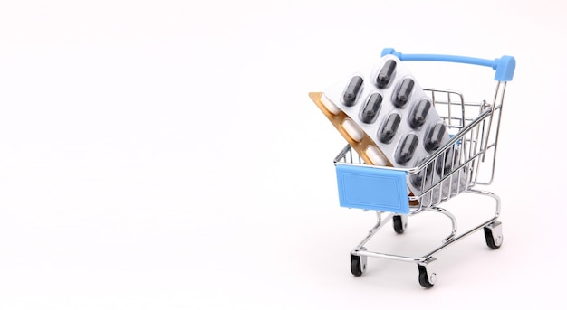 Shopping cart with drugs on a white background.