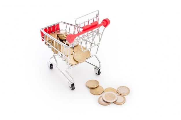 Shopping cart with euro coins falling from it on white background. conceptual representation of a failure, poverty and being broke. supermarket shopping, sale and cash back theme. copyspace for text.