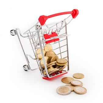 Shopping cart with euro coins in it is falling on white background. conceptual representation of a failure, poverty and being broke. supermarket shopping, sale and cash back theme. copyspace for text.