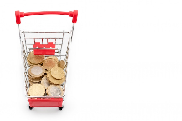 Shopping cart with euro coins in it on white background. supermarket shopping, sale and cash back theme. copyspace for text.