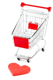 Shopping cart with heart on the white background