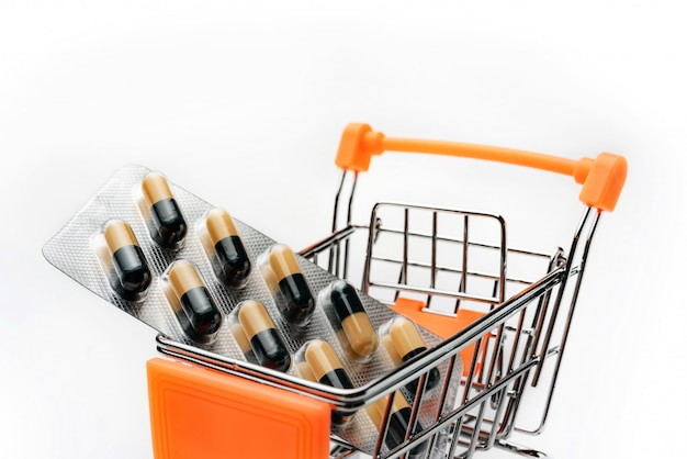 Shopping cart with medicines close-up