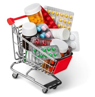 白い背景で隔離の丸薬とショッピングカート。