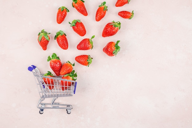Shopping concept composition with strawberries