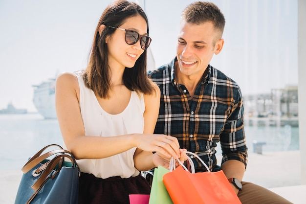 Shopping concept with couple in harbor area
