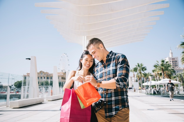 Shopping concept with couple at harbor