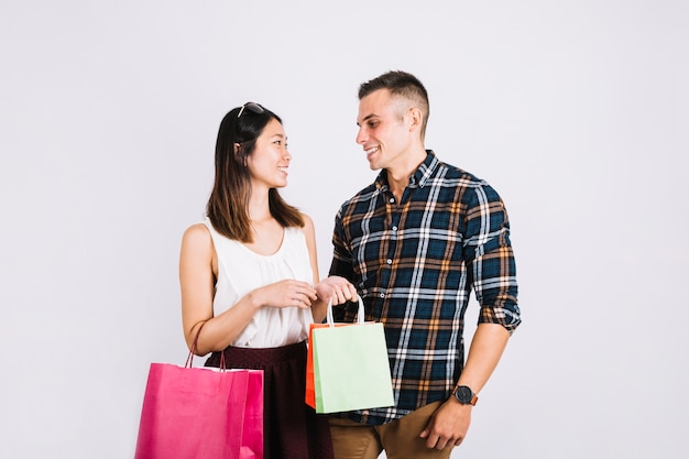 Shopping concept with couple looking at each other