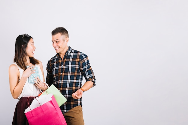 Shopping concept with couple and space on right