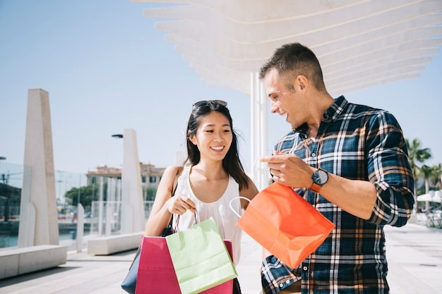 Shopping concept with couple in summer