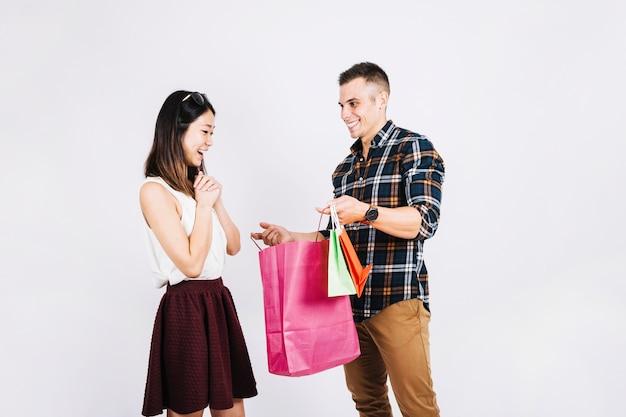 Shopping concept with man giving bags