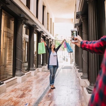 Shopping concept with woman posing for photo