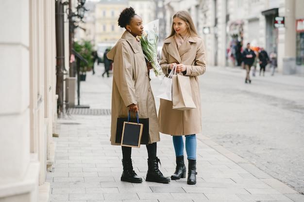Shopping day. international girlfriends. women in a city.