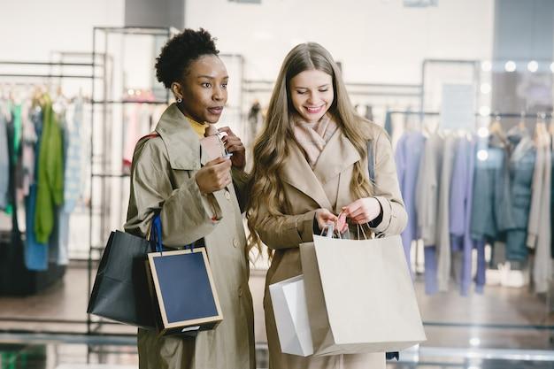 Shopping day. international girlfriends. women in a mall.