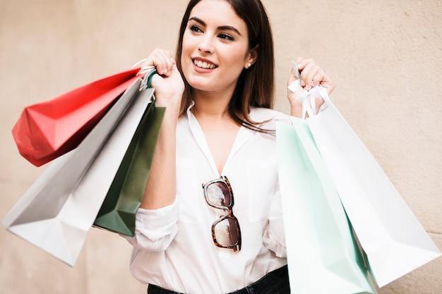 Shopping girl carrying bags