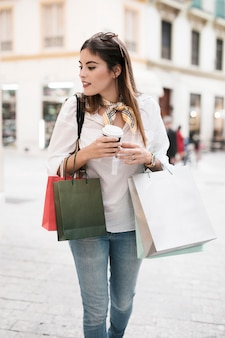 Shopping girl carrying bags