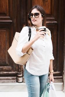 Shopping girl having a coffee