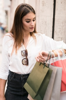 Shopping girl looking at her watch