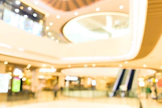 ショッピングモールの抽象的な焦点がぼけたぼやけた背景。ビジネスコンセプト。