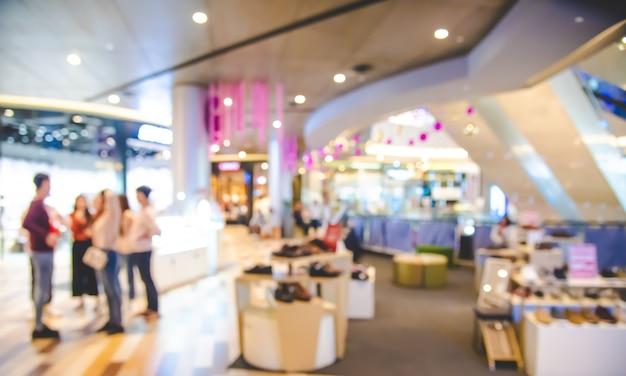 Торговый центр размыты в помещении с подсветкой для концепции образа жизни