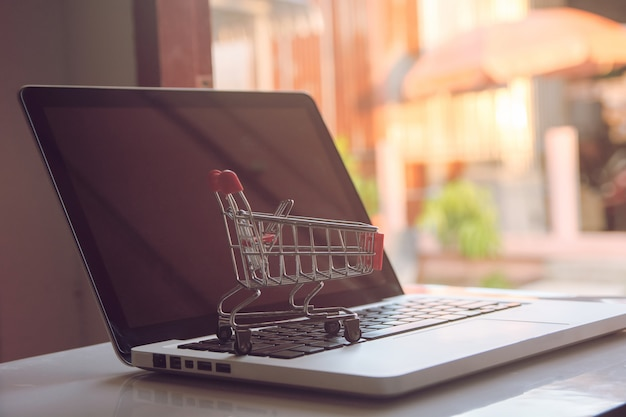 Shopping online concept empty shopping cart on a laptop keyboard