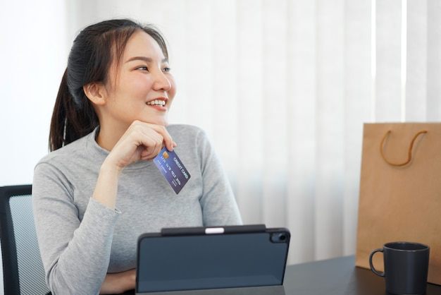 Shopping online concept a female shopper enjoys picking and purchasing products in an online shop.