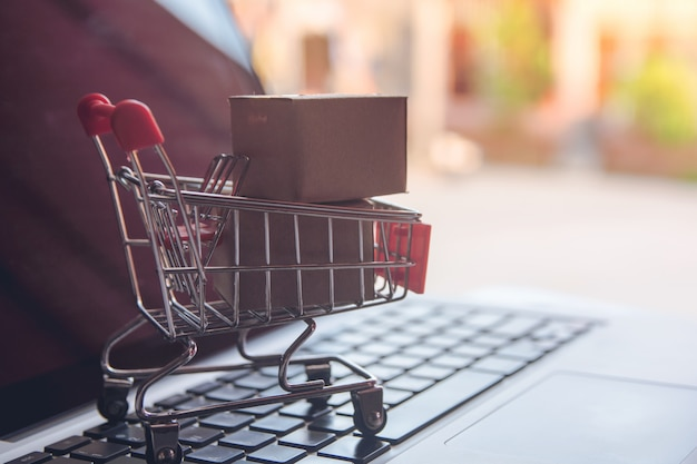 Shopping online concept - shopping with payment by credit card shopping cart on a laptop