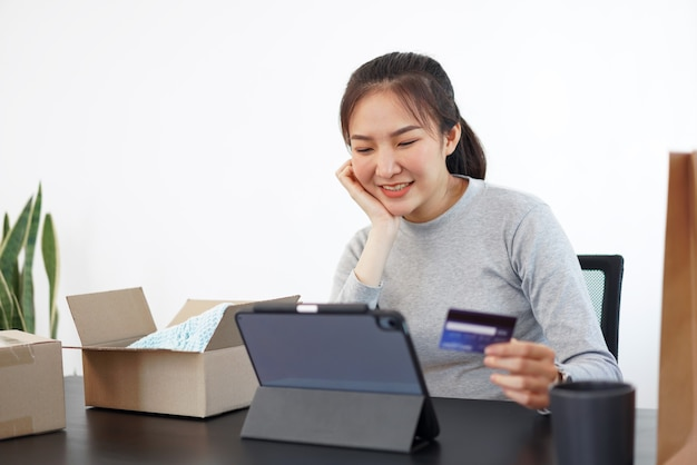 Shopping online concept a young woman using her credit card to facilitate   an online purchasing in online shopping application.